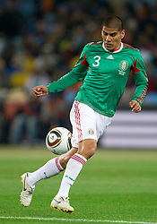 Carlos Salcido of Mexico during the 2010 FIFA World Cup South Africa Round of Sixteen match between Argentina and Mexico at Soccer City Stadium on June 27, 2010 in Johannesburg, South Africa. Argentina defeated Mexico 3-1 and qualified for quarterfinals. (Photo by Vid Ponikvar / Sportida)