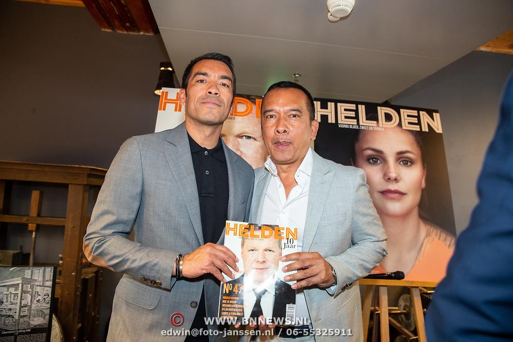 NLD/Amsterdam/201905229 - 10-jarig jubileum van Helden, Giovanni van Bronckhorst en zijn vader Victor