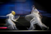 INDIANAPOLIS, IN - MARCH 26: Lee Kiefer of University of Notre Dame, left, fences with Alanna Goldie of The Ohio State University in the foil finals  during the Division I Women's Fencing Championship held at Indiana Farmers Coliseum on March 26, 2017 in Indianapolis, Indiana.