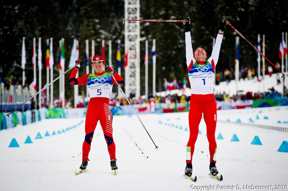 Justyna Kowalczyk, POL, (R) celebrates her victory over Marit Bjoergen, NOR, in the women's cross-country skiing 30 KM mass start classic during the 2010 Vancouver Winter Olympics in Whistler, British Columbia, Saturday, Feb. 27, 2010.