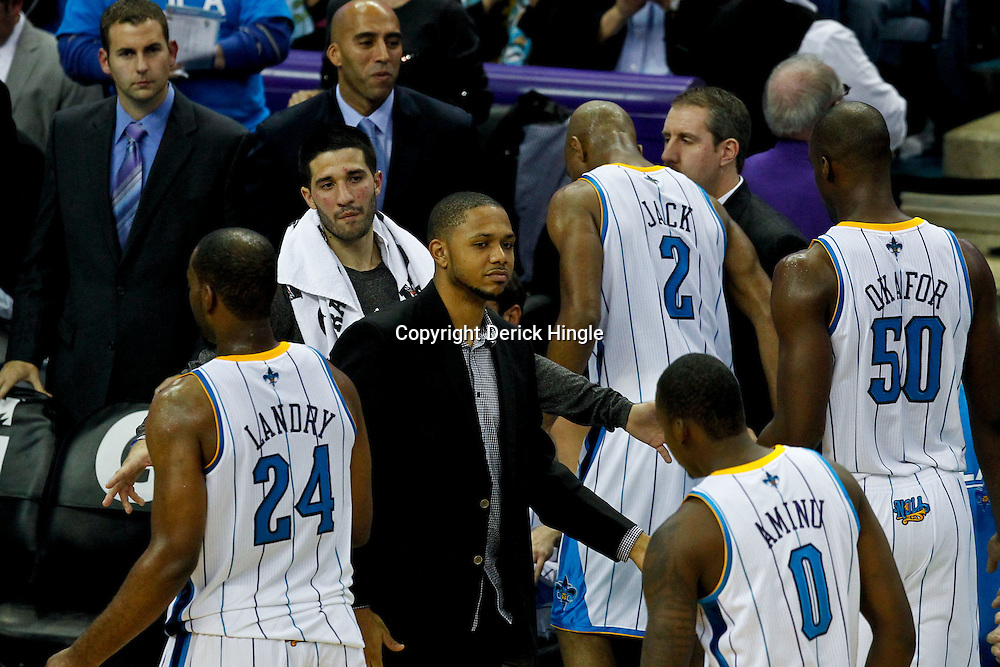 December 28, 2011; New Orleans, LA, USA; New Orleans Hornets shooting guard Eric Gordon (10) out with a bruised knee greets teammates as the come to the bench during a fourth quarter time out in a game against the Boston Celtics at the New Orleans Arena. The Hornets defeated the Celtics 97-78.  Mandatory Credit: Derick E. Hingle-US PRESSWIRE