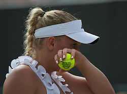 LONDON, ENGLAND - Monday, June 27, 2011: Caroline Wozniacki (DEN) with gold union jack finger nails in action during the Ladies' Singles 4th Round match on day seven of the Wimbledon Lawn Tennis Championships at the All England Lawn Tennis and Croquet Club. (Pic by David Rawcliffe/Propaganda)