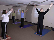 (left to right) Sandy Wright, from Beavercreek; Tory Klepacz, from Miami Township; Sarah Fulton, from Beavercreek and Jeff Bonsteel, from Centerville during a yoga class at The Studio, in Beavercreek, Thursday, March 22nd.