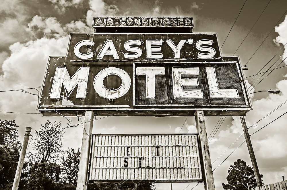 A rusting sign advertises Casey's Motel on Elvis Presley Boulevard, Sept. 3, 2015, in Memphis, Tennessee. The abandoned motel was closed after numerous nuisance complaints and a police crackdown on prostitution and other illegal activity in the area. (Photo by Carmen K. Sisson/Cloudybright)
