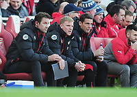 Football - 2016 / 2017 Premier League - Arsenal vs. Bournemouth<br /> <br /> Bournemouth Manager Eddie Howe with assistant Manager , Jason Tindall (right) and Neil Moss (goalkeeping coach) at The Emirates.<br /> <br /> COLORSPORT/ANDREW COWIE