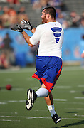 Buffalo Bills tight end Scott Chandler (84) catches a pre game pass before the 2014 NFL Pro Football Hall of Fame preseason football game against the New York Giants on Sunday, Aug. 3, 2014 in Canton, Ohio. The Giants won the game 17-13. ©Paul Anthony Spinelli