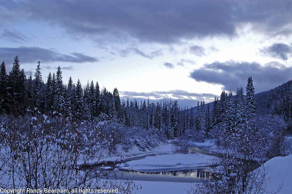 Yaak River after snowfall in winter. Yaak Valley in the Kootenai National Forest, Purcell Mountains, northwest Montana