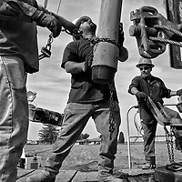 German Castro, 26, Pedro Bravo, 32, and Francisco Plata, 37, (From left to right) drill for water on a farm in Woodville in Tulare County in California's Central Valley, CA, Friday, Oct. 7, 2016. One of the worst droughts in California history officially ended this spring in all of the state's counties except Fresno, Kings, Tulare and Tuolumne. <br />