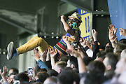 There's always one....AFC Wimbledon fans get vocal during  the Sky Bet League 2 Play-Off first leg match between AFC Wimbledon and Accrington Stanley at the Cherry Red Records Stadium, Kingston, England on 14 May 2016. Photo by Stuart Butcher.
