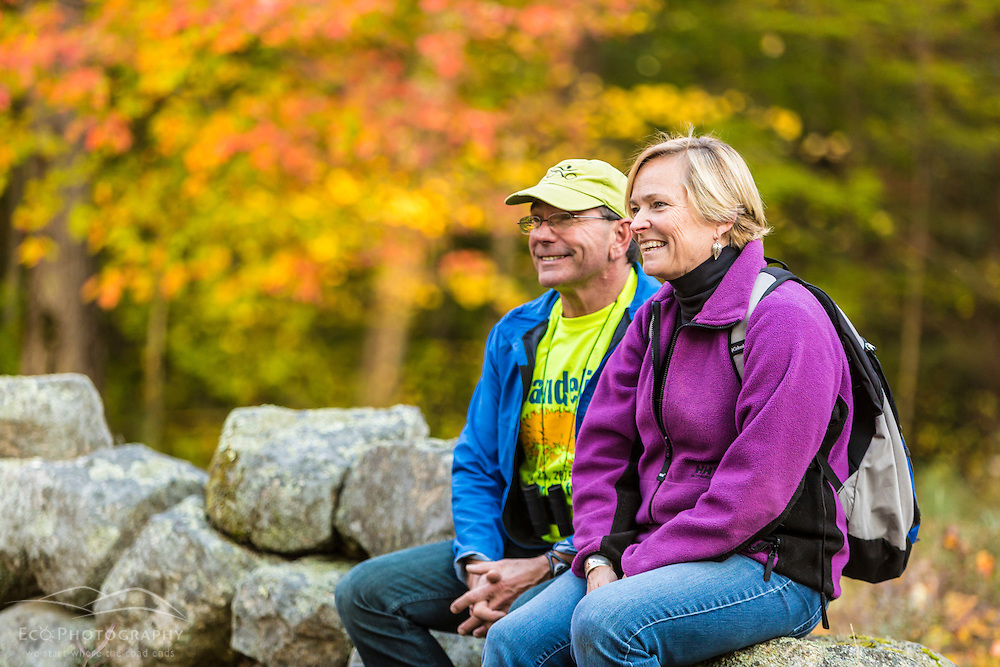 A couple enjoys a fall day in Barrington, New Hampshire.