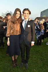 CHLOE HERBERT and brother WILL HERBERT at the 2014 Hennessy Gold Cup at Newbury Racecourse, Newbury, Berkshire on 29th November 2014.  The Gold Cup was won by Many Clouds ridden by Leighton Aspell.