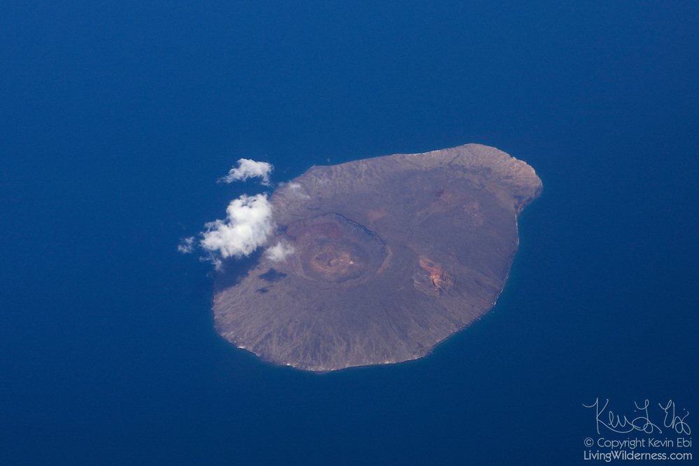 Isla Tortuga, an island located in the Gulf of California, Mexico, is the summit of a young shield volcano. The volcano reaches 689 feet (210 meters) above sea level. The caldera is nearly 350 feet (100 meters) deep. It is not known when Isla Tortuga last erupted. A shield volcano is a volcano with shallow-sloping sides. The Gulf of California is also known as the Sea of Cortez.