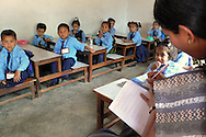 Teacher and students in a classroom B1276