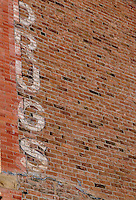 "Old painted ""Drug"" advertisement on side of historic brick building; Ridgway, CO"