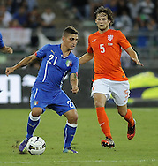 Marco Verratti of Italy and Daley Blind of Netherlands during the International Friendly match at Stadio San Nicola, Bari<br /> Picture by Stefano Gnech/Focus Images Ltd +39 333 1641678<br /> 04/09/2014