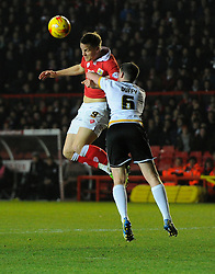 Bristol City's Matt Smith battles for the high ball with Port Vale's Richard Duffy  - Photo mandatory by-line: Joe Meredith/JMP - Mobile: 07966 386802 - 10/02/2015 - SPORT - Football - Bristol - Ashton Gate - Bristol City v Port Vale - Sky Bet League One