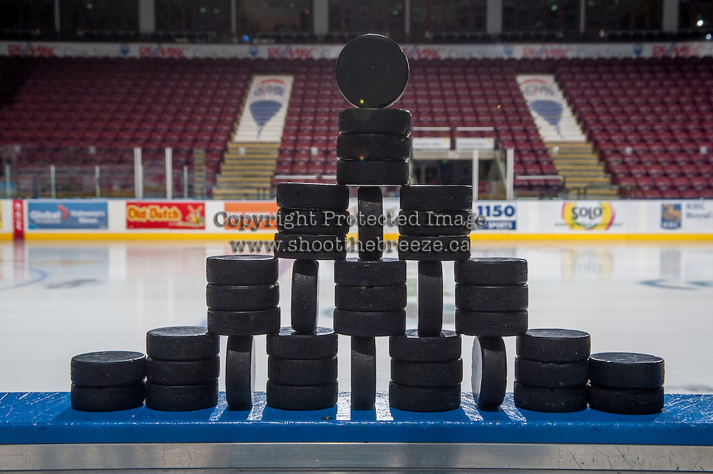 KELOWNA, CANADA - JANUARY 3: Hockey pucks stand on the bench prior to the warm up between the Kelowna Rockets and the Prince George Cougars on January 3, 2015 at Prospera Place in Kelowna, British Columbia, Canada.  (Photo by Marissa Baecker/Shoot the Breeze)  *** Local Caption ***