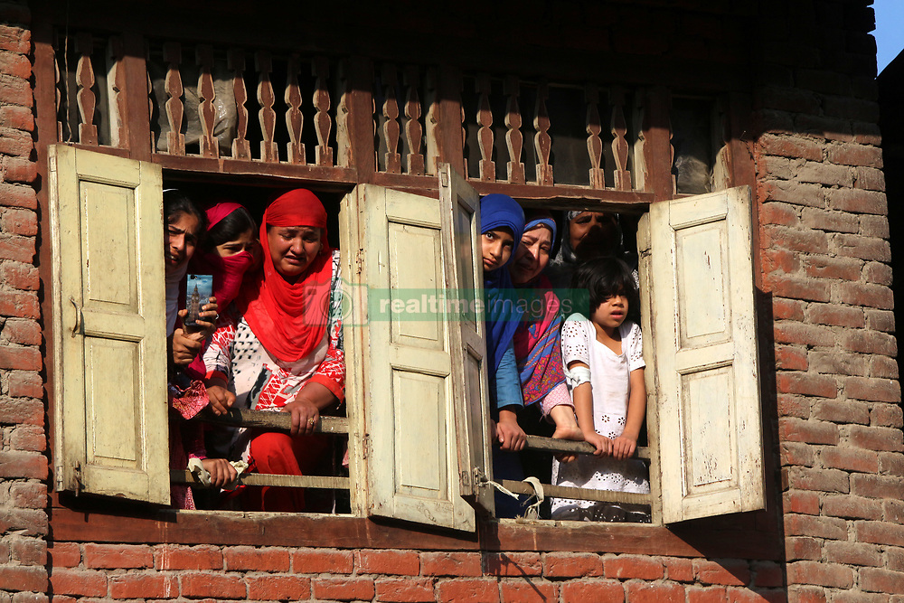August 4, 2017 - Anantnag, Jammu and Kashmir, India - Kashmiri Muslim women watching funeral procession from a window of a Slain  Hizb rebel Yawar alias Gazi  in Hanfia Eidgah in Janglatandi locality of old town Anantnag, 55 KMs South  of Srinagar. Yawar a 17 day old rebel was killed in an encounter with security forces in Kanelwan village in Dochnipora belt of Bijbehara in the same district on Thursday night. Two other rebels managed to escape from the area while as a civilian- Ghulam Muhamad Bhat from Arwani village of Bijbehara was also killed in the exchange of fire. (Credit Image: © Muneeb Ul Islam/Pacific Press via ZUMA Wire)