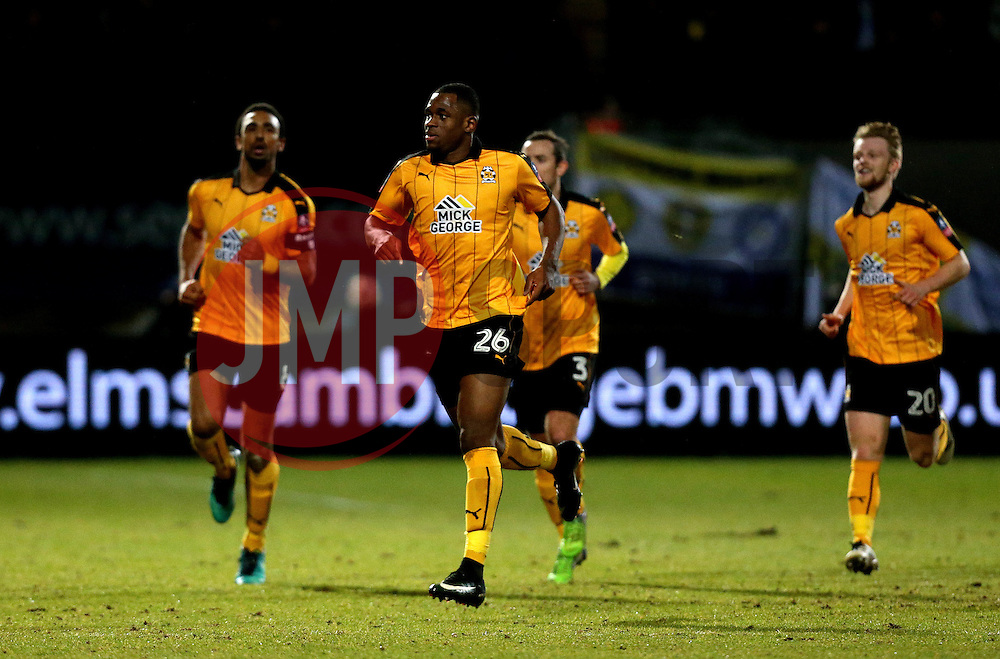 Uche Ikpeazu of Cambridge United celebrates with teammates after scoring a goal to make it 1-0 against Leeds United - Mandatory by-line: Robbie Stephenson/JMP - 09/01/2017 - FOOTBALL - Cambs Glass Stadium - Cambridge, England - Cambridge United v Leeds United - FA Cup third round