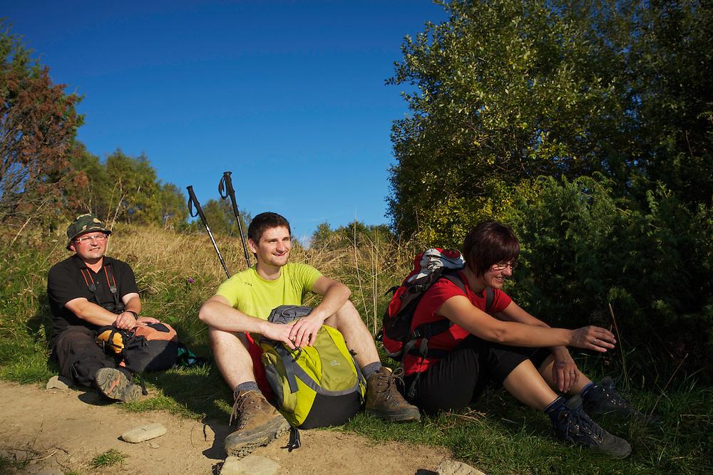 Grzegorz Sitko (in black with hiking poles), Anna & Grzegorz Mokrzyccy hiking in the mountains of Bieszczady National Park, Ustrzyki Górne, Poland.