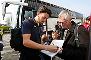 Wimbledon defender Will Nightingale (5) signing autographs during the EFL Sky Bet League 1 match between Scunthorpe United and AFC Wimbledon at Glanford Park, Scunthorpe, England on 30 March 2019.