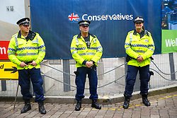 © Licensed to London News Pictures. 06/10/2015. Manchester, UK. Police officers guarding Conservative Party Conference at Manchester Central convention centre from anti-austerity protesters on Tuesday, 6 October 2015. Photo credit: Tolga Akmen/LNP