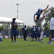 Steve Weatherford during punt training watched by kicker Josh Brown, (left) during the 2013 New York Giants Training Camp at the Quest Diagnostics Training Centre, East Rutherford, New Jersey, USA. 29th July 2013. Photo Tim Clayton.