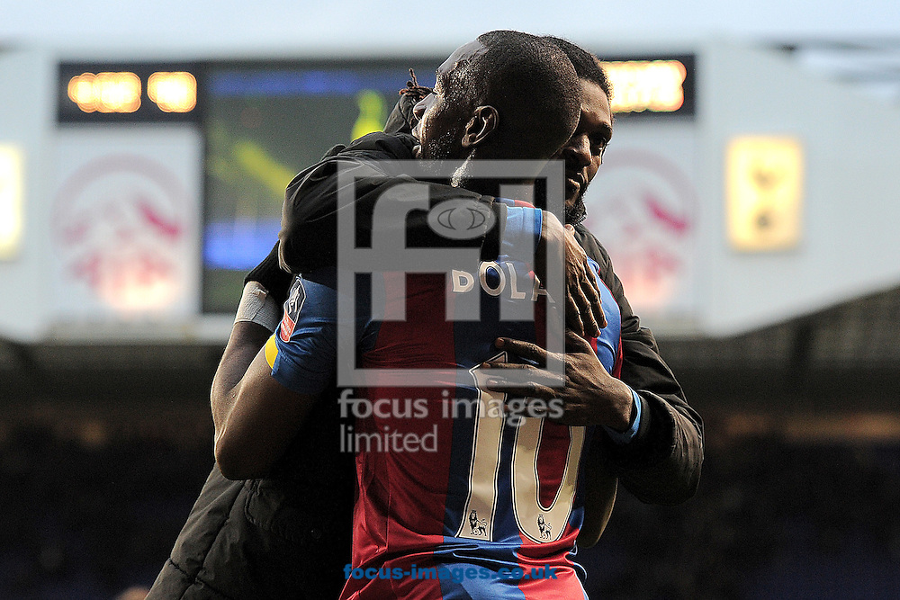 Yannick Bolasie of Crystal Palace congratulates Emmanuel Adebayor of Crystal Palace at the final whistle during the FA Cup match between Tottenham Hotspur and Crystal Palace at White Hart Lane, London<br /> Picture by Richard Blaxall/Focus Images Ltd +44 7853 364624<br /> 21/02/2016