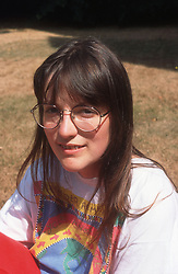 Portrait of woman wearing glasses smiling,