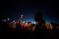 A candlelight vigil draws thousands to the Pine Trails Park amphitheater Thursday, Feb. 15, 2018, to mourn a day after the mass shooting at Marjory Stoneman Douglas High School in Parkland. (XAVIER MASCAREÑAS/TREASURE COAST NEWSPAPERS)