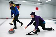 Jen Beck of Irondequoit plays a shot and Jeff Pulli prepares to sweep during a match at Rochester Curling Club on Sunday, February 8, 2015.