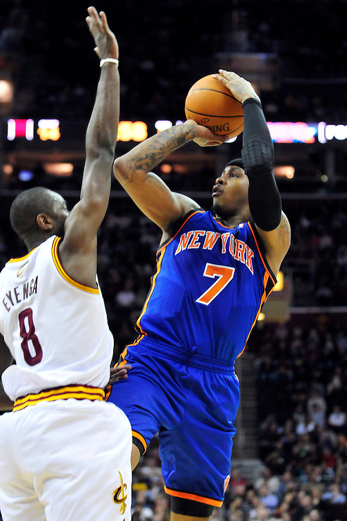 Feb. 25, 2011; Cleveland, OH, USA; New York Knicks small forward Carmelo Anthony (7) shoots over Cleveland Cavaliers guard Christian Eyenga (8) during the second quarter at Quicken Loans Arena. Mandatory Credit: Jason Miller-US PRESSWIRE