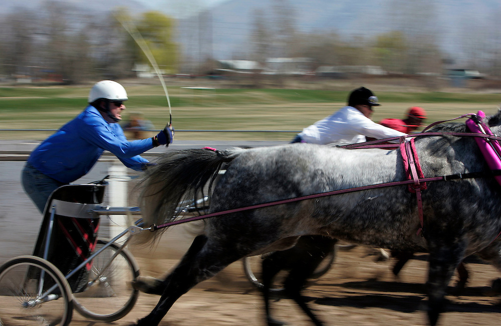 A couple of teams of horses compete in a race during the first weekend of the World Championships of Cutter & Chariot Racing is held at the Golden Spike Events Center at the Weber County Fairgrounds in Ogden, Utah , Saturday, March 24, 2007. The final races will be held on Saturday and Sunday March 31st and April 1st at the same location. This weekends races are part of the qualifying races for next weekends finals. August Miller/ Deseret Morning News