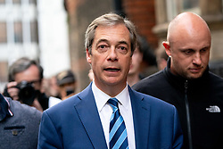 © Licensed to London News Pictures. 29/03/2019. Former Leader of UKIP, Nigel Farage, leaves after speaking on stage at a Leave Means Leave demonstration in Westminster on the day that Britain was originally due to leave the European Union. MPs today rejected Theresa May's withdrawal deal for the third time. Photo credit : Tom Nicholson/LNP