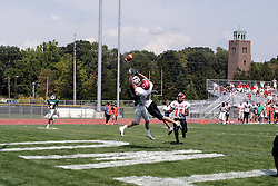 09 September 2006 Olivet defender Nate hughes gets between the ball and the intended receiver Martin Geisel..In the first ever football competition between the Olivet Comets and the Illinois Wesleyan Titans, the Titans strut off the field with a 21- 6 victory. .Game action took place at Wilder Field on the campus of Illinois Wesleyan University in Bloomington Illinois.
