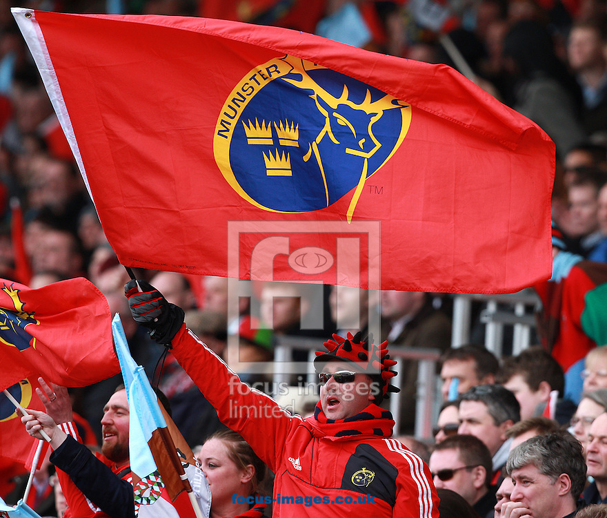 Picture by Paul Terry/Focus Images Ltd +44 7545 642257.07/04/2013.A Munster fan celebrates as his team wins the Heineken Cup match at Twickenham Stoop , London.