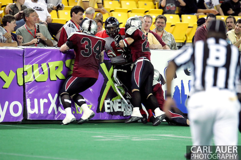 6-28-2007: Anchorage, AK - Kendrick Wade (1) gets pinned against the boards by the Wild defense as the CenTex Barracudas hand the Alaska Wild another loss 53-47 as the Barracudas make the trip up to Alaska.