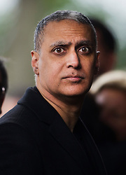 © London News Pictures. 05/11/2014. British Indian musician, NITIN SAWHNEY arriving at the service. The funeral Jack Bruce at Golders Green Crematorium in North London. Jack Bruce was the lead singer and bass player for British Rock band Creme, alongside Eric Clapton and Ginger Baker. Creme sold over 15 million albums worldwide and were widely considered to be the worlds first successful supergroup. Photo credit : Ben Cawthra/LNP
