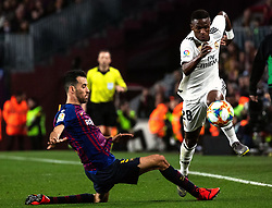 BARCELONA, Feb. 7, 2019  Real Madrid's Vinicius Junior (R) competes with FC Barcelona's Sergio Busquets during the Spanish King's Cup semifinal first leg match between FC Barcelona and Real Madrid in Barcelona, Spain, on Feb. 6, 2019. The match ended with a 1-1 draw. (Credit Image: © Joan Gosa/Xinhua via ZUMA Wire)