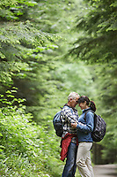 Couple embracing in forest side view