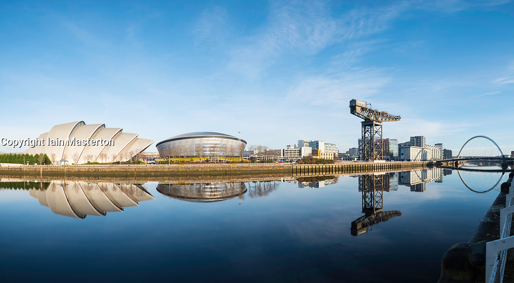 View of SEC Armadillo and SSE Hydro beside River Clyde on blue sky winter day, Scotland, United Kingdom
