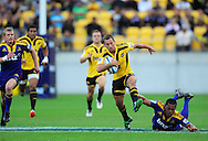 Hurricanes first five Aaron Cruden tries to skip out of the tackle of Alando Soakai. Super 15 rugby match - Hurricanes v Highlanders at Westpac Stadium, Wellington, New Zealand on Friday, 18 February 2011. Photo: Dave Lintott/PHOTOSPORT
