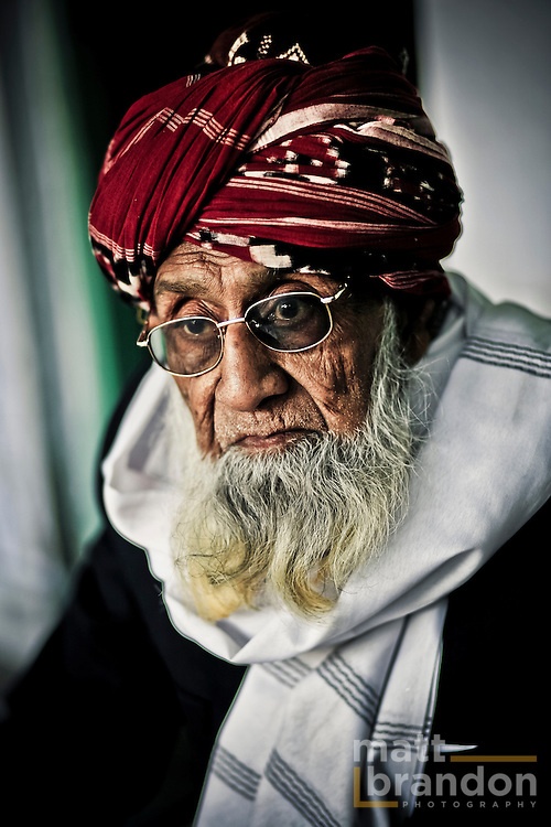 A classic face of a Muslim man in the shrine of Nizamuddin.
