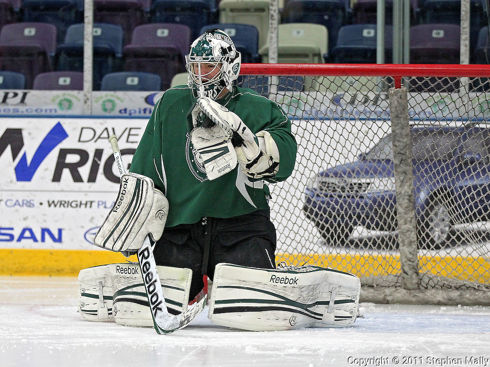 RoughRiders goalie Matt McNeely gloves a puck during a practice at the Cedar Rapids Ice Arena, 1100 Rockford Road SW, in Cedar Rapids on Tuesday, December 13, 2011. (Stephen Mally/Freelance)