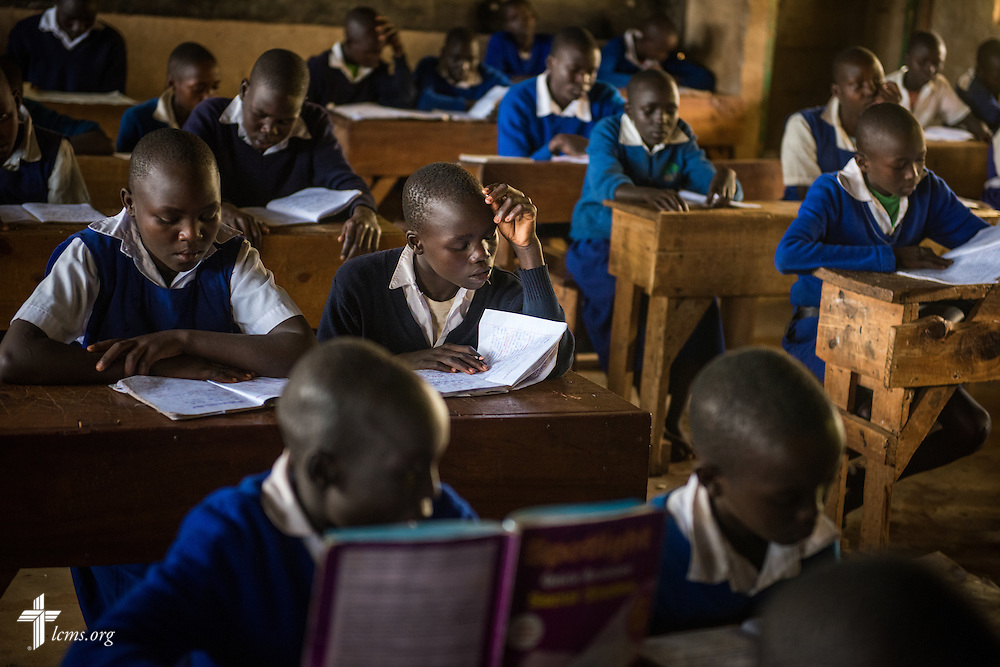 Several students (middle row) from the U-Dom ELCK (Evangelical Lutheran Church in Kenya) Project 24 site prepare for exams on Thursday, June 23, 2016, at the Propoi Primary School in Chepareria, Kenya.  LCMS Communications/Erik M. Lunsford