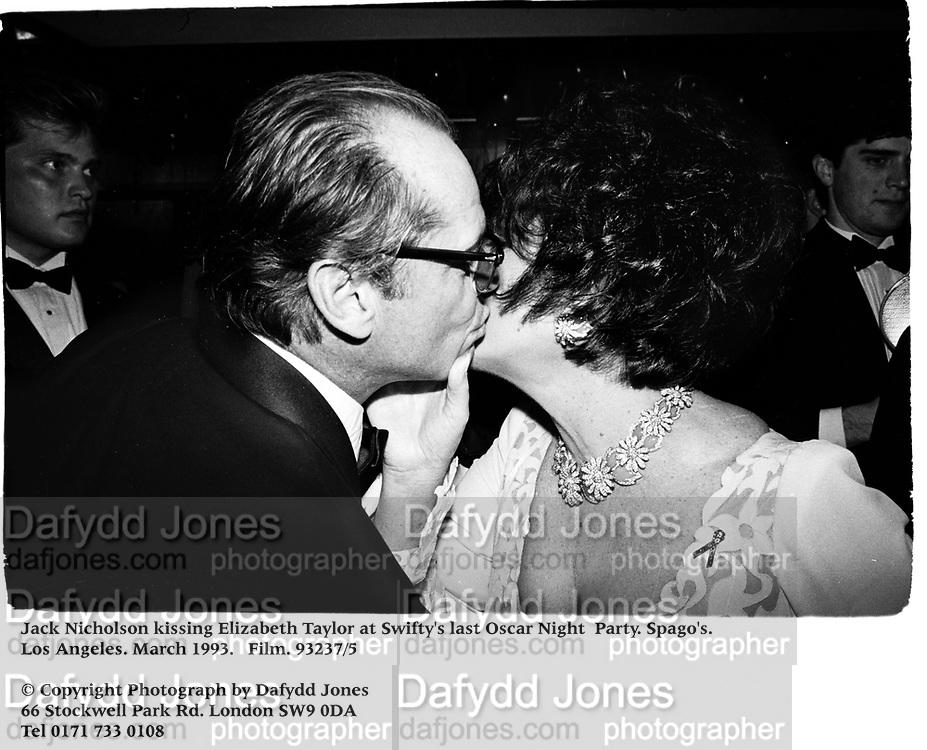 Jack Nicholson kissing Elizabeth Taylor at Swifty's last Oscar Night  Party. Spago's. Los Angeles. March 1993. Film. 93237/5<br /><br />© Copyright Photograph by Dafydd Jones<br />66 Stockwell Park Rd. London SW9 0DA<br />Tel 0171 733 0108