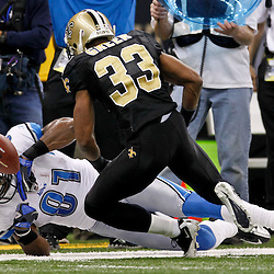 January 7, 2012; New Orleans, LA, USA; New Orleans Saints cornerback Jabari Greer (33) breaks up a pass intended for Detroit Lions wide receiver Calvin Johnson (81) during the 2011 NFC wild card playoff game at the Mercedes-Benz Superdome. Mandatory Credit: Derick E. Hingle-US PRESSWIRE