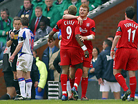 Photo: Paul Thomas.<br /> Blackburn Rovers v Liverpool. The Barclays Premiership. 16/04/2006.<br /> <br /> Liverpool's Djibril Cisse is held back by team mate John Arne Riise after having words with Blackburn's David Bentley over the tackle by Paul Dickov.