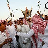 At the annual national heritage festival, men and women attend on different days, in adherence with Saudi Arabia's strict code of separation between the sexes. Getting caught with an unrelated woman can mean arrest, a possible flogging and dishonor. March 2008.