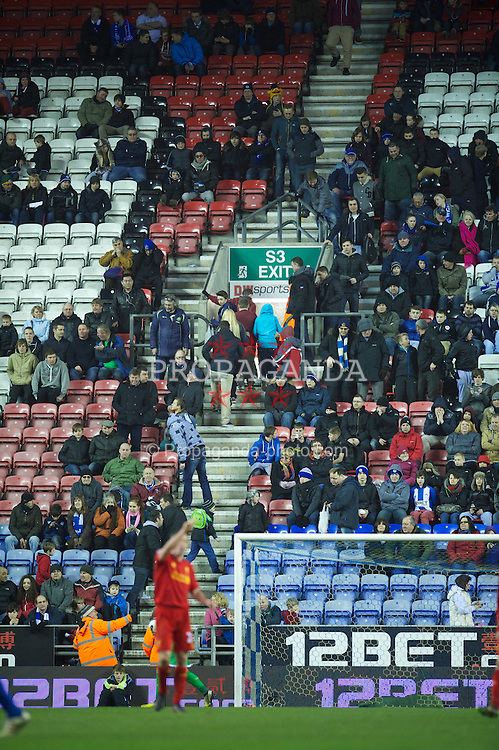 WIGAN, ENGLAND - Saturday, March 2, 2013: Wigan Athletic supporters leave in their droves as their side lose 4-0 to Liverpool during the Premiership match at the DW Stadium. (Pic by David Rawcliffe/Propaganda)